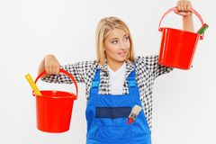 Young woman holding buckets with paint Royalty Free Stock Images