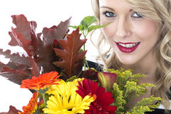 Young Woman Holding a Bunch of Flowers Royalty Free Stock Image