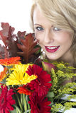 Young Woman Holding a Bunch of Flowers Stock Photos