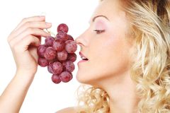 Young woman  holding bunch of grapes Royalty Free Stock Photo