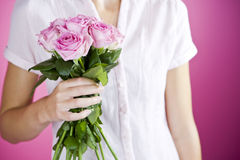 A Young Woman Holding A Bunch Of Pink Roses Royalty Free Stock Image