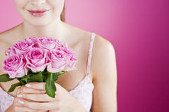 A Young Woman Holding A Bunch Of Pink Roses Stock Photos