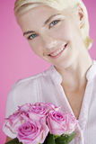 A Young Woman Holding A Bunch Of Pink Roses Stock Images