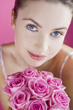 A Young Woman Holding A Bunch Of Pink Roses Stock Image