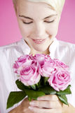A Young Woman Holding A Bunch Of Pink Roses Royalty Free Stock Photos