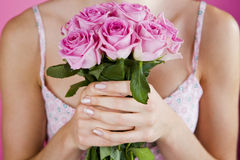 A Young Woman Holding A Bunch Of Pink Roses Royalty Free Stock Images