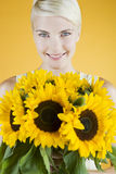 A Young Woman Holding A Bunch Of Sunflowers Stock Images