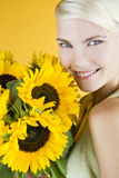 A Young Woman Holding A Bunch Of Sunflowers Royalty Free Stock Photos