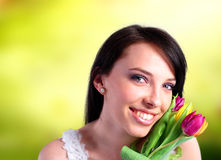 Young woman holding a bunch of tulips Royalty Free Stock Images