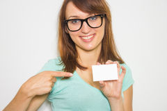 Young woman holding business card isolated on white background. Stock Images
