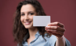 Young woman holding a business card Royalty Free Stock Photography