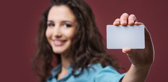Young woman holding a business card Stock Photography