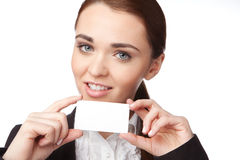 Young woman holding a business card on the white background Stock Photos