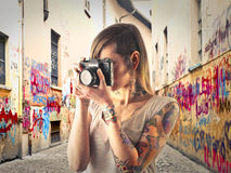 Young woman holding a camera Royalty Free Stock Image