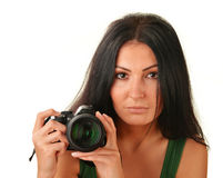 Young woman holding camera isolated on white. Taking pictures Royalty Free Stock Photos