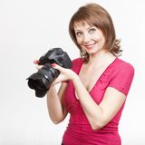 Young woman holding camera and looking photos Royalty Free Stock Images