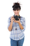 Young woman holding camera for taking picture. On white background Stock Photo