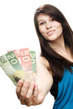 Young woman holding canadian currency Stock Photo