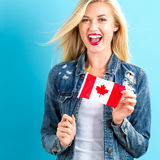 Young woman holding Canadian flag Royalty Free Stock Photography