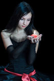 Young woman holding candle Royalty Free Stock Images