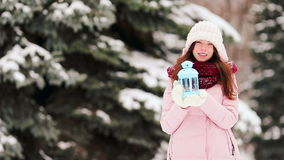 Young woman holding candlelight to warm her hands outdoors stock video footage