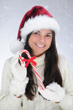 Young Woman holding a Candy Cane Royalty Free Stock Images