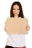 Young woman holding a cardboard. Royalty Free Stock Photo