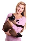 Young woman holding cat Royalty Free Stock Images
