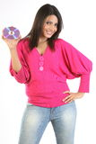 Young woman holding CD disk. Smiling young woman holding CD disk stock photo