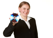 Young woman holding cd or dvd Stock Photos