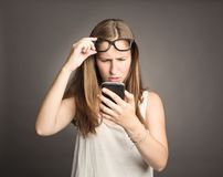Young woman holding a cellular Stock Photography