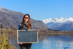 Young woman holding a chalkboard Royalty Free Stock Image