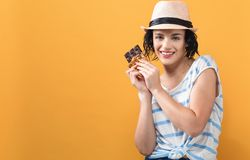 Young woman holding chocolate. On a solid background royalty free stock image