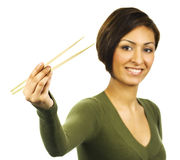 Young Woman holding chopsticks Royalty Free Stock Image