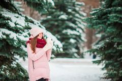 Beautiful woman outdoors on beautiful winter snow day in forest Stock Images