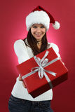 Young woman holding christmas gift Royalty Free Stock Photography