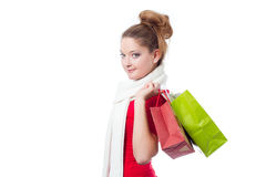 Young woman holding christmas gift bags Royalty Free Stock Photo