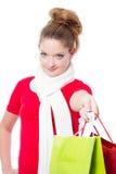 Young woman holding christmas gift bags Stock Image