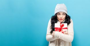 Young woman holding a Christmas gift Stock Images