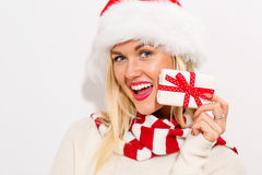 Young woman holding a Christmas gift Royalty Free Stock Image