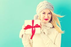 Young woman holding a Christmas gift royalty free stock photo