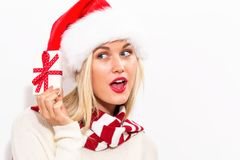 Young woman holding a Christmas gift stock photography