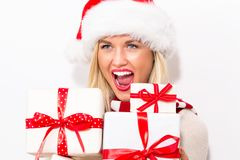 Young woman holding Christmas gifts stock images
