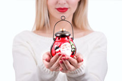 A young woman,holding a Christmas lantern with a candle. Christmas flashlight.Gifts and accessories for Christmas royalty free stock images