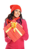 Young woman holding a Christmas present Royalty Free Stock Photo