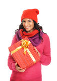 Young woman holding a Christmas present Stock Photos