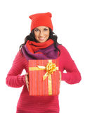 Young woman holding a Christmas present Stock Photo