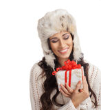 Young woman holding a Christmas present Royalty Free Stock Photography