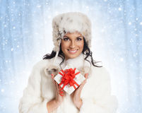 Young woman holding a Christmas present Royalty Free Stock Images