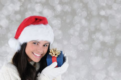 Young Woman Holding Christmas Present Royalty Free Stock Images